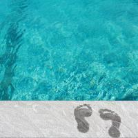 Footsteps by a pool